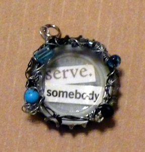 bottlecap pendant with black & silver wire and blue accents